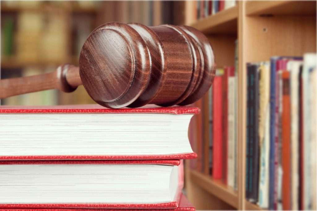 Legal books with judge's mallet