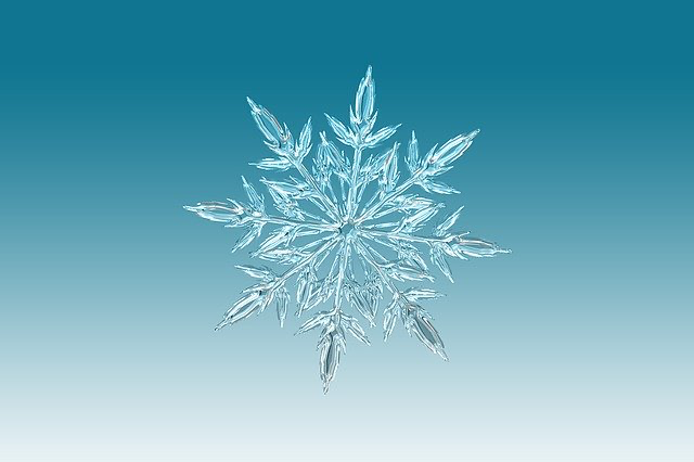 pale blue background with ice snowflake picture